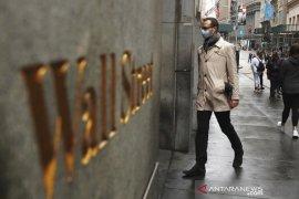 Wall Street melonjak didorong reli saham keuangan dan obat anti virus COVID-19