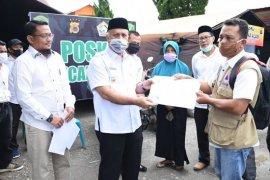 Warga korban banjir bandang Aceh Tengah terima kembali KTP dan KK