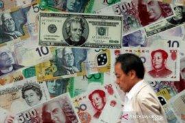 Dolar AS sedikit menguat, pasar fokus pada lonjakan kasus baru virus corona