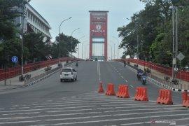 Perbandingan suasana pusat Kota Palembang pada Idul Fitri hari ini dan tahun lalu Page 1 Small