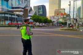 Selasa pagi, ruas jalan wilayah Jakarta sepi dan lancar