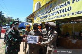 Pangdam Merdeka salurkan paket lebaran ke petugas kesehatan perbatasan Atinggola