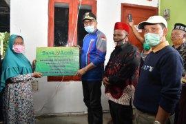Plt Gubernur Aceh serahkan rumah bantuan Bank Aceh Syariah