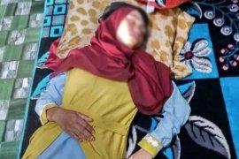 Seorang gadis ditemukan warga tertidur dipinggir jalan nasional