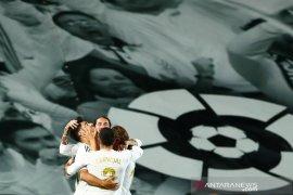 Real Madrid bersaing ketat dengan Barcelona di klasemen Liga Spanyol