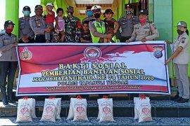 Sambut HUT Bhayangkara Polres Tapteng dan Kodim 0211/TT gelar bakti sosial