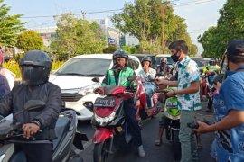 BPJS Kesehatan-PWI Sidoarjo bagikan masker kepada masyarakat