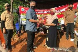 Offroader BBJC salurkan bantuan beras Polda Kalsel di pelosok Tapin