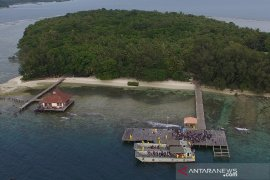 Reporting on COVID-19 mass quarantine 500 meters from Sebaru Kecil