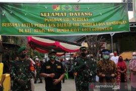 Pangdam Xlll/Merdeka  bagikan bantuan bagi korban banjir Gorontalo