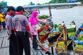 S Kalimantan tourism police escort health protocol at tourist sites