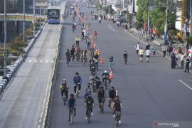 Bersepeda saat pandemi corona wajib jaga jarak 20 meter