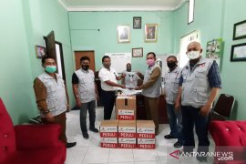 Dukung relawan COVID-19, Pertamina EP-Field Rantau beri bantuan APD
