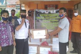 Baznas Sanggau Salurkan Bantuan Kemanusiaan Banjir Bandang Desa Nekan Kec.Entikong.
