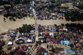 Dampak banjir bandang di kota Masamba Page 1 Small