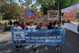 Polresta Denpasar menilai demo tolak tes cepat dan usap langgar Perwali