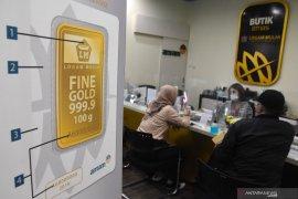 Harga emas Antam Rp1.011.000/gram, turun Rp10.000,
