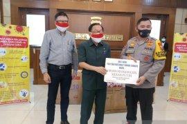 Maspion Grup sumbangkan 100 ribu masker kepada Polda Jatim