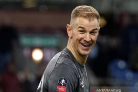 Joe Hart akan berlabuh di Tottenham Hotspur