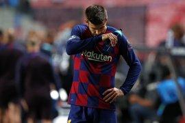 Gerard Pique terancam absen tiga pekan akibat cedera