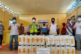 PT Pamapersada Nusantara dispenses jerry cans for palm sugar small business