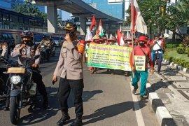 Polisi kawal aksi petani Deli Serdang menuju Istana Negara