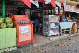 """Meski tak untung pedagang pasar  Setu Babakan patuhi pengaturan """"ganjil-genap"""""""