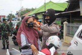 Polres Bangka Barat bagikan 30.000 masker kain gratis