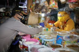 Polda Kaltim dan Kodam VI Mulawarman bagikan 470 ribu masker