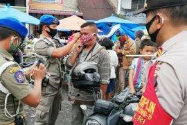 Sosialisasi penegakan hukum protokol kesehatan dan 4.000 masker di Simalungun