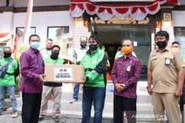 Sekdaprov Bali serahkan 30 ribu masker untuk pengemudi ojol