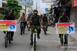 Brimob Polda Sumut sosialisasi protokol kesehatan dengan bersepeda