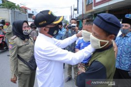 Bupati Asahan bagikan ribuan masker kepada masyarakat kota Kisaran