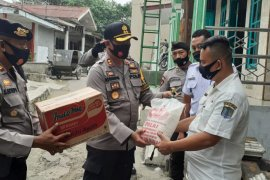 Kapolres Binjai bantu korban banjir