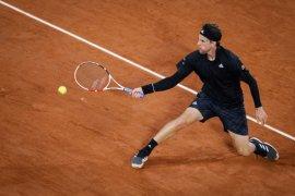 Unggulan ketiga Dominic Thiem melenggang ke babak keempat Roland Garros setelah hentikan Ruud