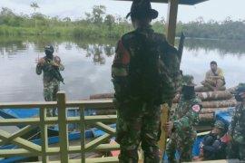 Satgas Pamtas tangkap empat pelaku illegal logging di Sambas