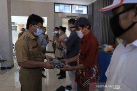 Putus penyebaran COVID-19, BPBD Kota Tangerang bagikan masker kain ke 1.014 RW