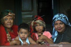 Keluarga Dengan Sindrom Waardenburg di Nagari Sungayang   Page 1 Small