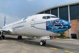 Garuda desain masker di pesawat bagian sosialisasi protokol kesehatan