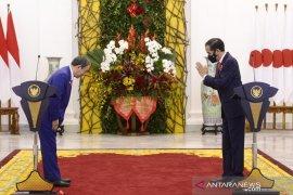 """Kunjungan PM Jepang dan awal citra Indonesia """"aman"""" COVID-19"""