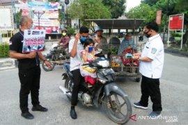 Cegah warga terinfeksi COVID-19, Satres Narkoba Tanjungbalai bagikan 350 masker