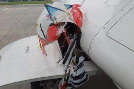 Ada layangan tersangkut di roda pesawat  saat akan mendarat di  Bandara Adisutjipto