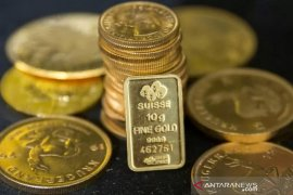 Harga emas melonjak saat dolar  AS tertekan prospek stimulus