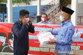 Tapin Health Agency distributes 26 thousand masks