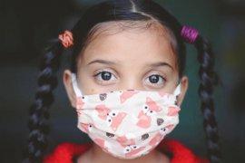 Begini cara benar gunakan masker untuk buah hati