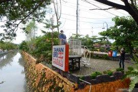 BRI Bersih-berih sungai dan bangun ruang terbuka hijau di Sukareme Bandar Lampung