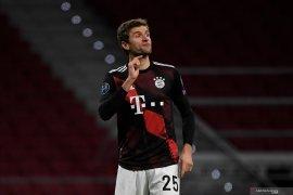 Gol penalti Thomas Mueller hambat laju Atletico Madrid ke fase gugur
