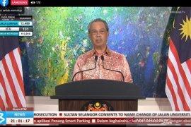 Perdana Menteri Malaysia menerima suntikan vaksin COVID-19