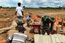 Denzipur 11/MA membantu pembangunan pondok pesantren As-Syifa Merauke
