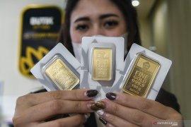 "Harga Emas tergelincir 5,8 dolar terseret penguatan \""greenback\"" dan saham"